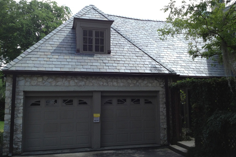 View of the slate roof on the residence garage.