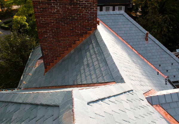 Copper snow guards were installed on this slate roof project.