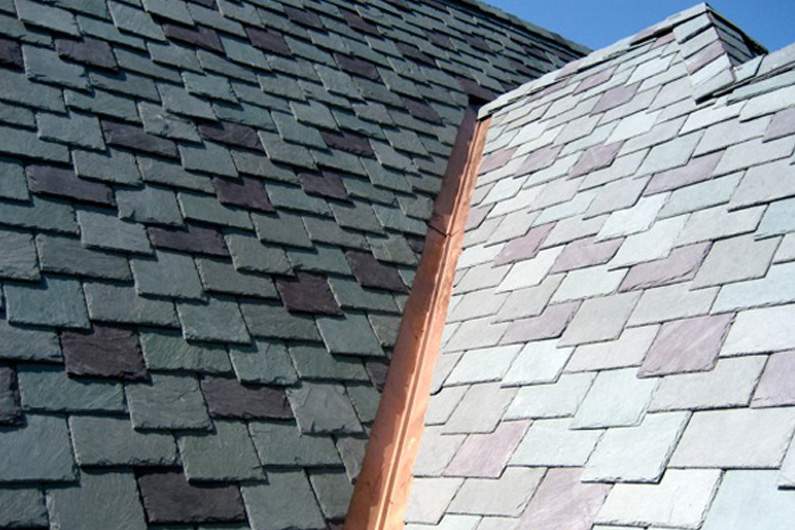 Slate roof with copper valleys.
