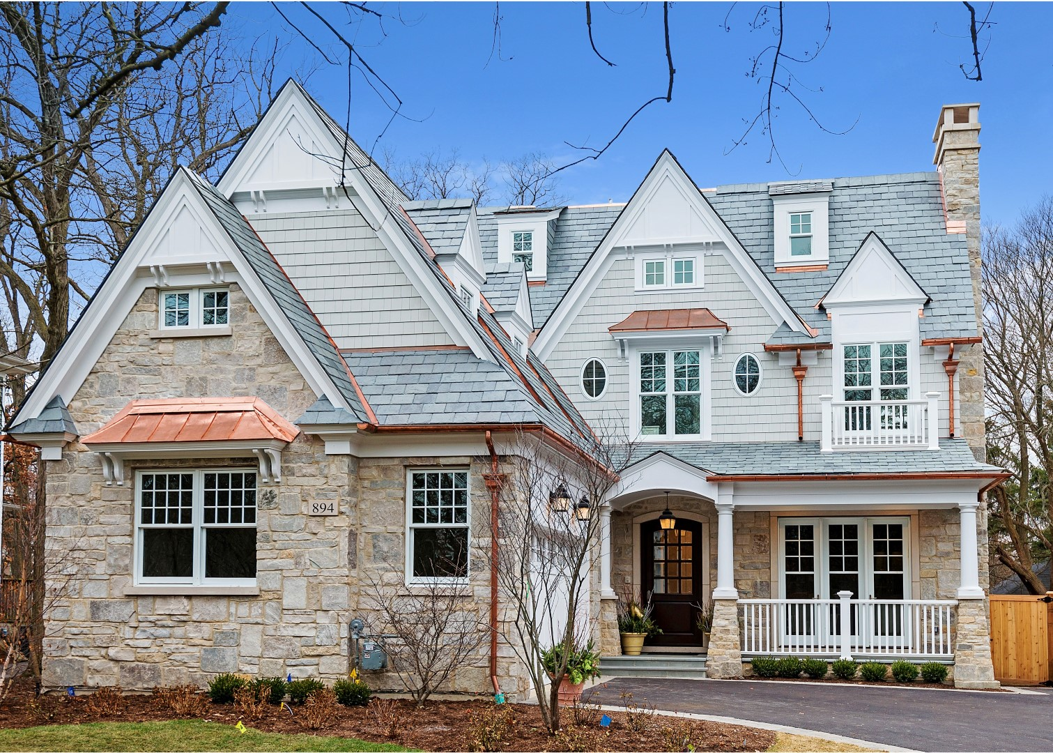 Coastal Nantucket style home with slate roof - front of home