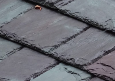 Slate roof using Non-weathering Mottled Green / Purple slate