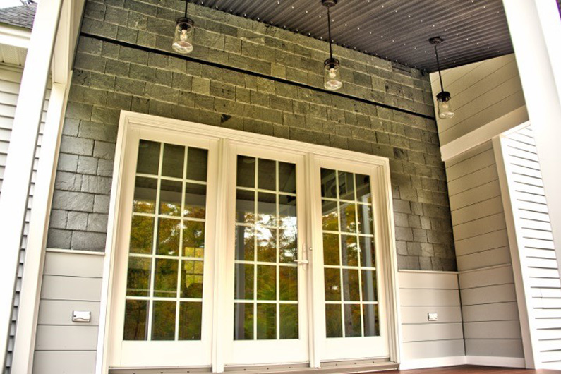 Greenstone Vermont Slate installed on exterior wall of home