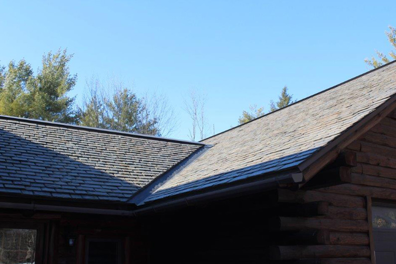 Standard Grade Rough Texture 1/4″-3/8″ thick slate was used on the house and garage.