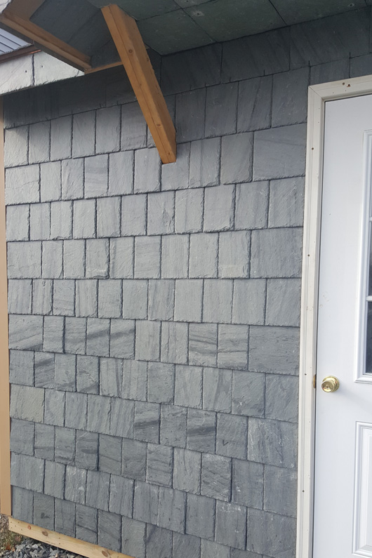 SlateTec slate installation system was used to install slate walls of this shed. A straight copper nail installation method was used on this side of the building.